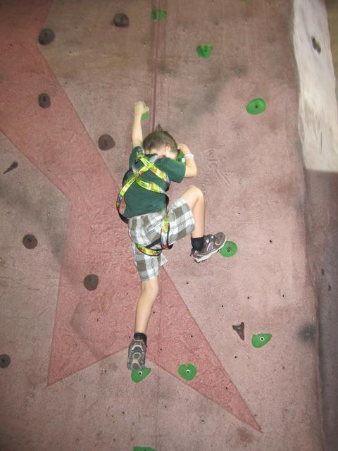 child climbing rock wall at Red Mountain Multigenerational Center