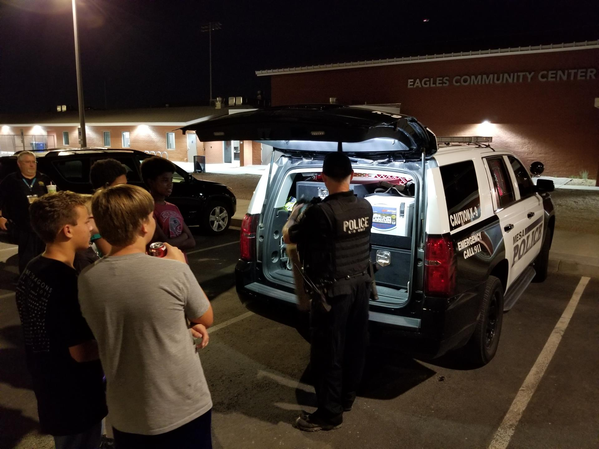 Mesa Police Department K9 Unit visited the Teen PLAE program at Eagles Community Center - unloading vehicle